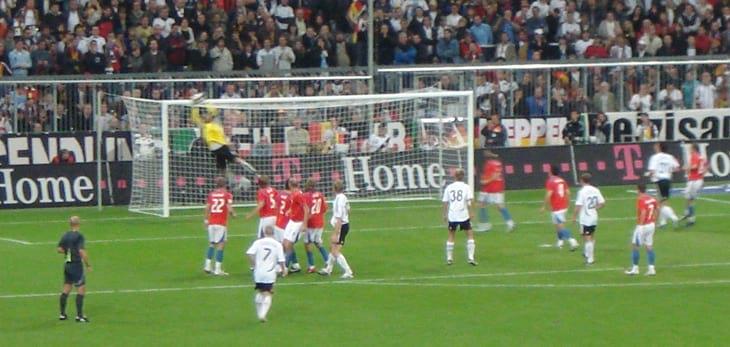 Soccer goal being saved by goalie on the Czech Republic Prague Football Field